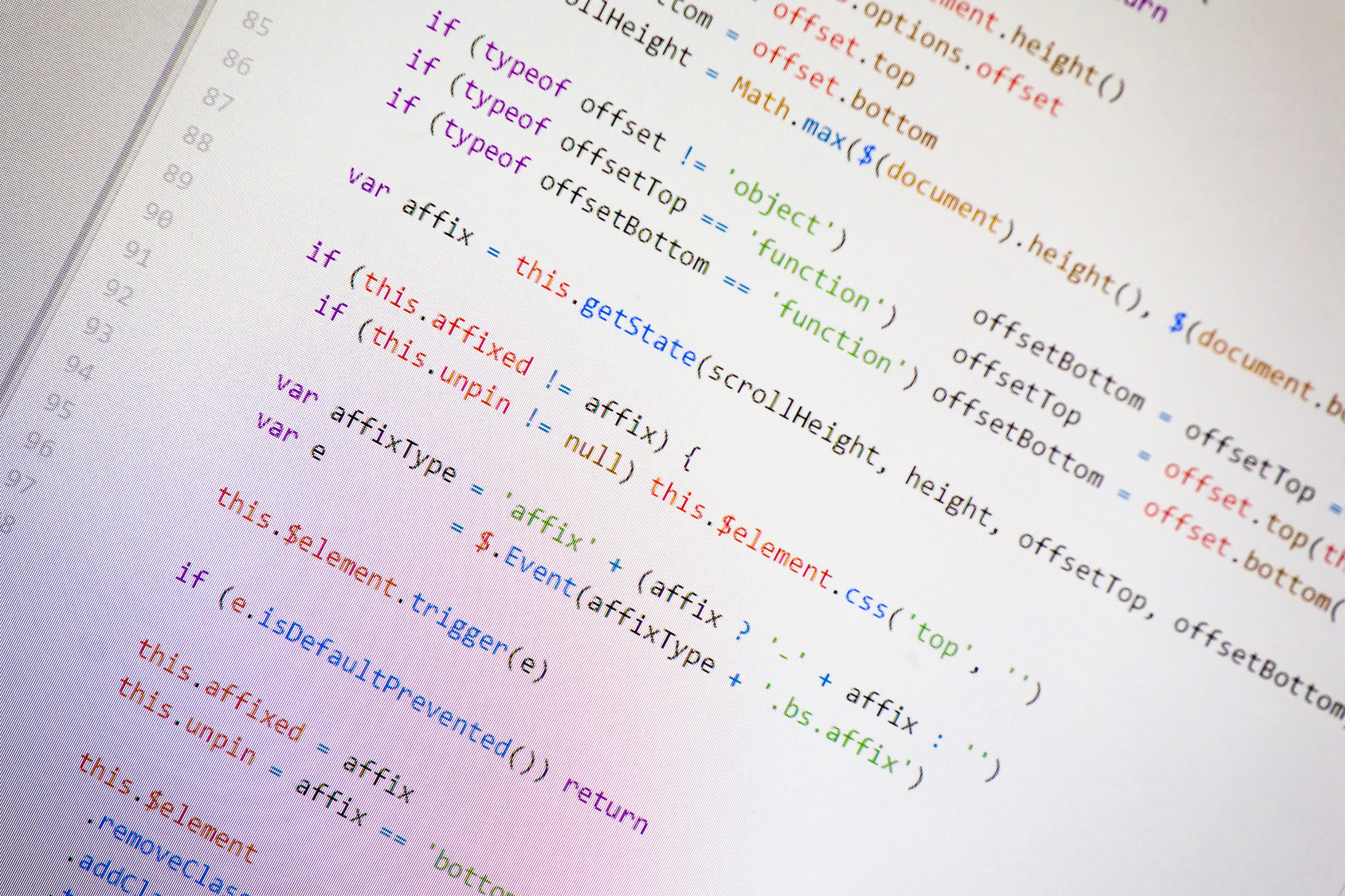 Colorful programming php and html source code on a monitor written by a young programmer.
